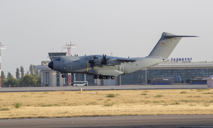 In this handout image provided by the Bundeswehr, a military aircraft arrives at Tashkent Airport carrying evacuees from Kabul in Tashkent, Uzbekistan, on Aug. 17, 2021. (Marc Tessensohn/Bundeswehr via Getty Images)