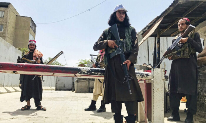 Taliban fighters stand guard at a checkpoint near the U.S. Embassy that was previously manned by U.S. troops in Kabul, Afghanistan, on Aug. 17, 2021. (AP Photo)
