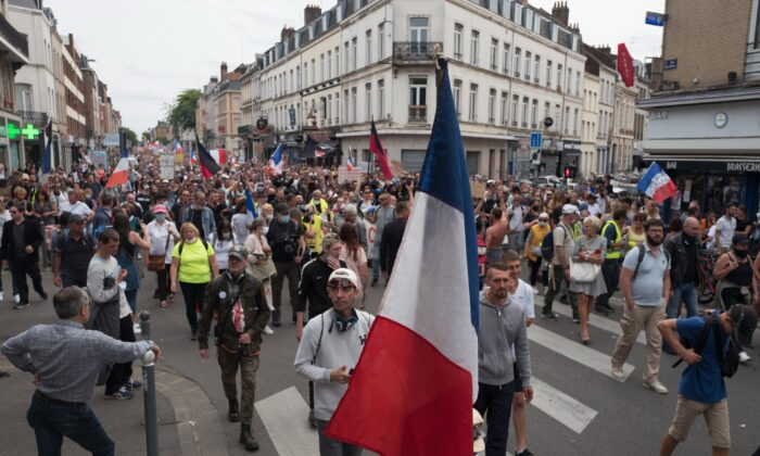 Demonstrators march during a rally against the COVID-19 health pass in Lille, northern France, on Aug. 21, 2021. (Michel Spingler /AP Photo)