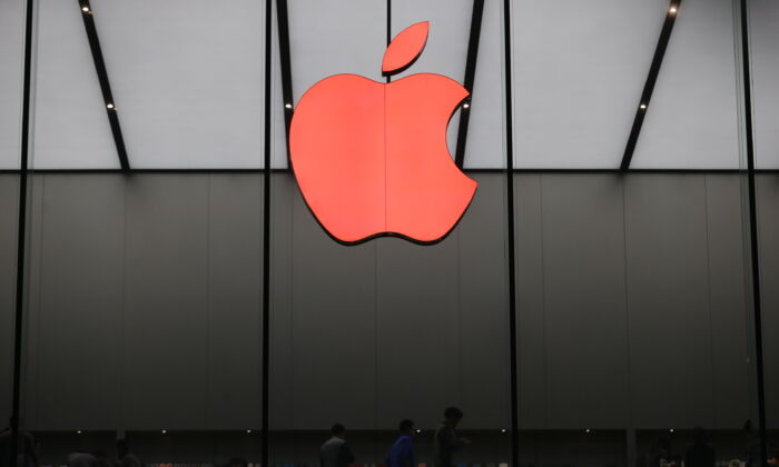 A red Apple logo is seen on the Apple store on World AIDS Day, December 1, 2015 in Hangzhou, Zhejiang Province, China.  (Xu Kangping/VCG/Getty Images)
