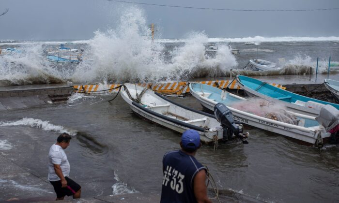 Fishermen remove their boats from the dock in the Veracruz state of Mexico, on Aug. 20, 2021. (Felix Marquez/AP Photo)