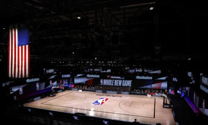 An empty court and bench is shown following the scheduled start time in Game Five of the Eastern Conference First Round between the Milwaukee Bucks and the Orlando Magic during the 2020 NBA Playoffs at AdventHealth Arena at ESPN Wide World Of Sports Complex in Lake Buena Vista, Fla., on Aug. 26, 2020. (Kevin C. Cox/Pool Photo/File/USA TODAY Sports)
