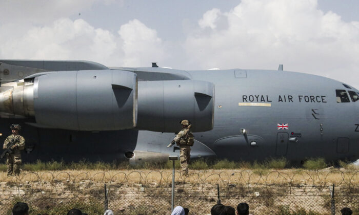 Members of the UK Armed Forces taking part in the evacuation of entitled personnel from Kabul airport in Afghanistan, on Aug. 20, 2021. (LPhot Ben Shread/Ministry of Defence via AP)
