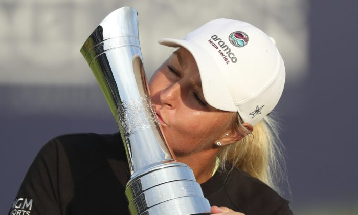 Sweden's AnnaNordqvist kisses the trophy as she poses for the media after winning the Women's British Open golf championship, in Carnoustie, Scotland, on Aug. 22, 2021. (Scott Heppell/AP Photo)