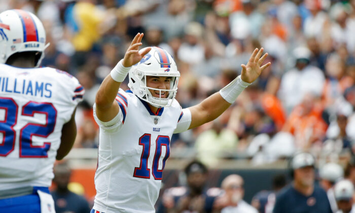 Buffalo Bills quarterback Mitchell Trubisky (10) smiles after a touchdown against the Chicago Bears at Soldier Field in  Chicago, Ill., on Aug 21, 2021. (Jon Durr/USA TODAY Sports via Reuters)