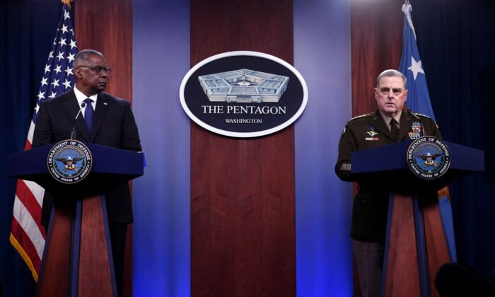 Defense Secretary Lloyd Austin (L) and Joint Chiefs Chairman Gen. Mark Milley hold a press conference about the situation in Afghanistan, at the Pentagon in Washington, on Aug. 18, 2021. (Olivier Douliery/AFP via Getty Images)
