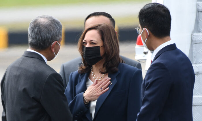 U.S. Vice President Kamala Harris (C) is greeted by Singapore's Foreign Minister Vivian Balakrishnan (L) upon her arrival at Paya Lebar Base airport in Singapore on Aug. 22, 2021. (Roslan Rahman/AFP via Getty Images)
