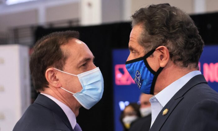 Howard Zucker, commissioner of the New York State Department of Health, and Gov. Andrew Cuomo after a press conference on COVID-19 vaccination at Suffolk County Community College in Brentwood, N.Y., on April 12, 2021. (Michael M. Santiago/Pool/AFP via Getty Images)