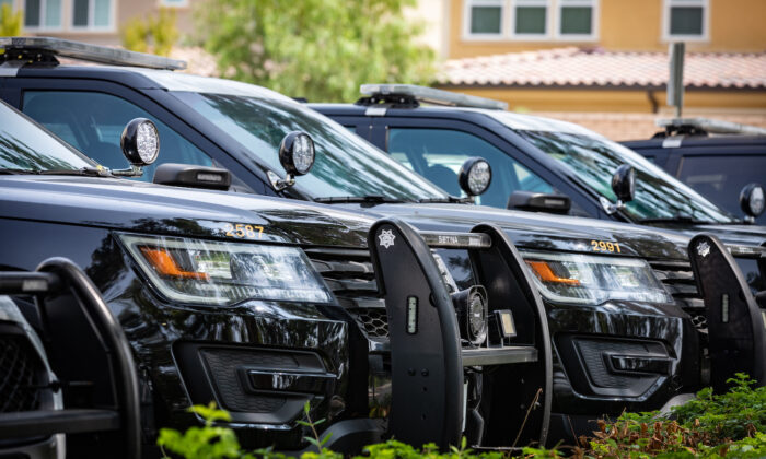 In this file photo, police cars are shown in Lake Forest, Calif., on Sept. 14, 2020. (John Fredricks/The Epoch Times)
