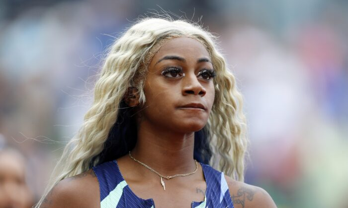Sha'Carri Richardson reacts after finishing last in the 100m race during the Wanda Diamond League Prefontaine Classic at Hayward Field, in Eugene, Ore., on Aug. 21, 2021. (Jonathan Ferrey/Getty Images)