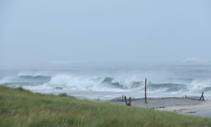 Waves hit the shore at Ponquogue Beach as Hurricane Henri, now downgraded to a tropical storm, nears the coast in Long Island, N.Y., on Aug. 22, 2021. (Caitlin Ochs/Reuters)
