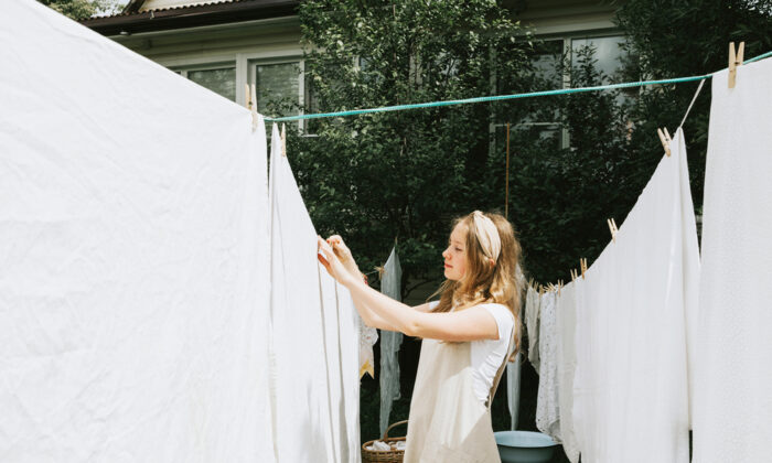 If your home is like most, you have the perfect vessel large enough to hand-launder blankets, making them line-ready to air-dry. It's the bathtub. (KlavdiyaV/Shutterstock)
