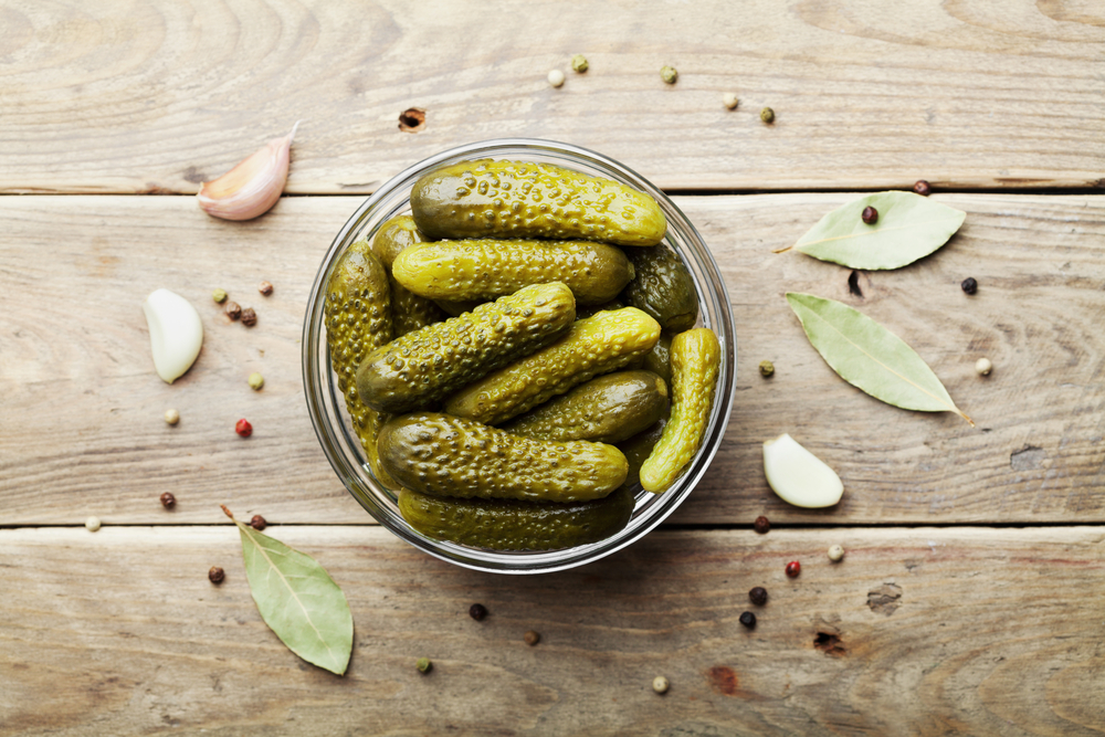 Pickled,Gherkins,Or,Cucumbers,In,Bowl,On,Wooden,Rustic,Table