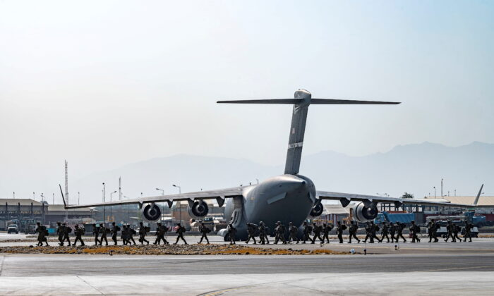U.S. soldiers, assigned to the 82nd Airborne Division, arrive to provide security in support of Operation Allies Refuge at Hamid Karzai International Airport in Kabul, Afghanistan, on Aug. 20, 2021. (Senior Airman Taylor Crul/U.S. Air Force/Handout via Reuters)