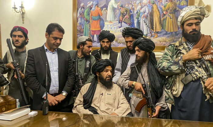 Taliban terrorists take control of Afghan presidential palace after the Afghan President Ashraf Ghani fled the country, in Kabul, Afghanistan, on Aug. 15, 2021. (Zabi Karimi/AP Photo)