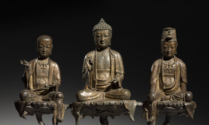 """The """"Amitabha Triad,"""" 1400s, by an unknown artist of the Joseon Dynasty (1392–1910), Korea. Bronze with traces of gilding; 16 inches by 6 1/2 inches by 21 1/2 inches. Worcester R. Warner Collection, the Cleveland Museum of Art. (Public Domain)"""