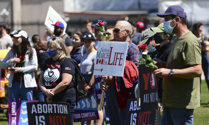 """People take part in a """"March For Life"""" against abortion on Parliament Hill in Ottawa on May 13, 2021. (The Canadian Press/Sean Kilpatrick)"""