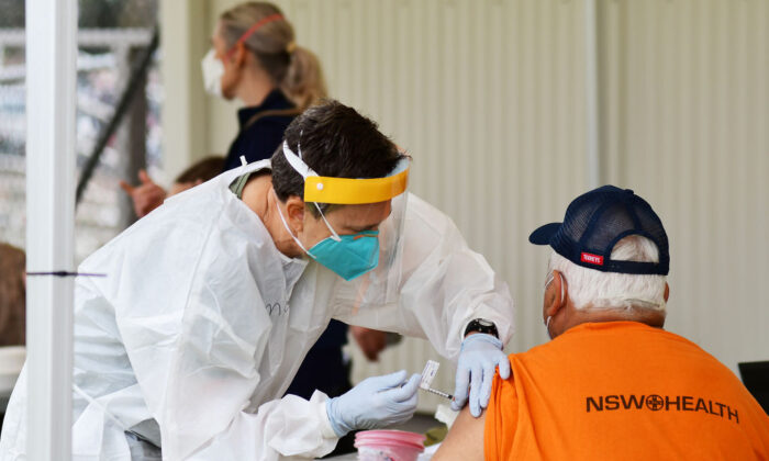 A man receives a dose of a COVID-19 vaccine at a newly opened vaccination hub in Dubbo, NSW, Australia, on Aug. 21, 2021. (Belinda Soole/Getty Images)