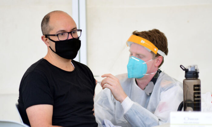 A man receives a dose of a COVID-19 vaccine at a newly opened vaccination hub in Dubbo, Australia, on Aug. 21, 2021. (Belinda Soole/Getty Images)