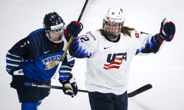 Kelly Pannek (R) of the United States, celebrates her goal as Finland's Jenni Hiirikoski skates past during second period IIHF women's world championship hockey action in Calgary, Alberta, Canada, on Aug. 22, 2021. (Jeff McIntosh/The Canadian Press via AP)