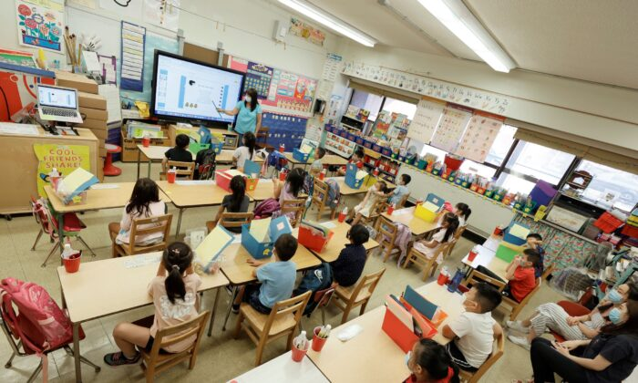 A teacher with summer program students are seen on a monitor at Yung Wing School P.S. 124, in New York City, on July 22, 2021. (Michael Loccisano/Getty Images)