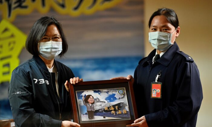 Taiwan President Tsai Ing-wen (L) receives a souvenir during her inspection of a Republic of China Navy (commonly called the Taiwan Navy) fleet in Keelung, Taiwan, on March 8, 2021. (Sam Yeh/AFP via Getty Images)