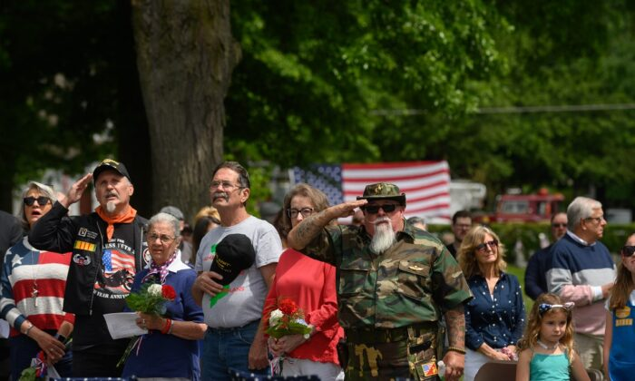 Veterans salute during the singing of the National Anthem in the Oakmont-Verona Cemetery during a memorial service at the 2021 Oakmont-Verona Memorial Day Parade in Oakmont, Penn. on May 31, 2021.  (Jeff Swensen/Getty Images)