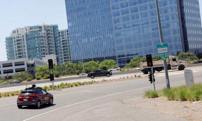 An autonomous electric vehicle drives in Irvine, Calif., on April 28, 2020. (Mike Blake/Reuters)