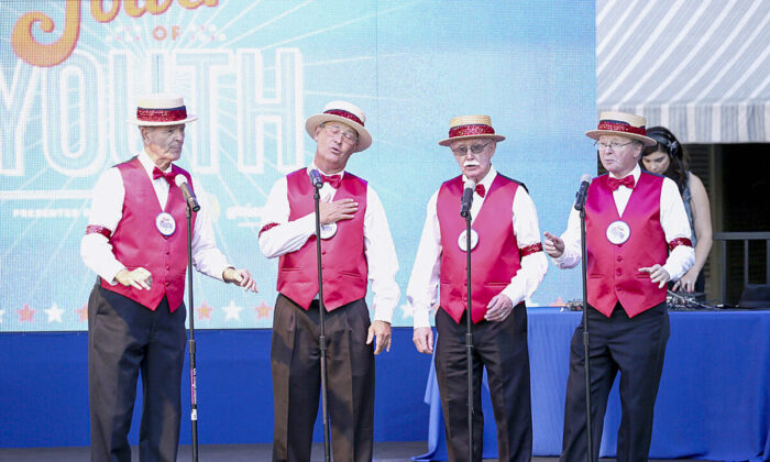 A barbershop quartet perform on July 27, 2013 in Universal City, California.  (Imeh Akpanudosen/Getty Images for Variety)