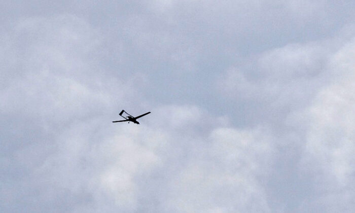 File photo of a drone flying over the sky in Syria. (George Ourfalian/AFP via Getty Images)