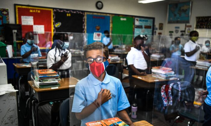 Students wear masks as they attend their first day in school after summer vacation at the St. Lawrence Catholic School north of Miami, on Aug. 18, 2021. (Chandan Khanna/AFP via Getty Images)