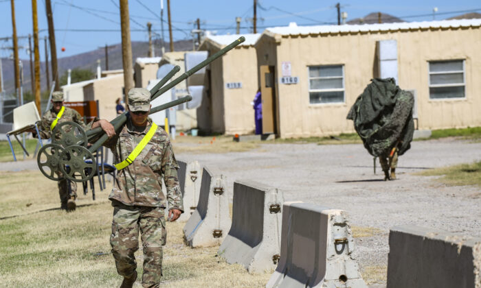 Soldiers prepare spaces for Afghan evacuees near Fort Bliss, New Mexico, on Aug. 19, 2021. (U.S. Army photo by: Staff Sgt. Michael West/2ABCT)