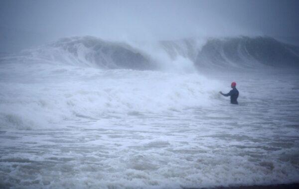 man-walks-out-into-atlantic-ocean