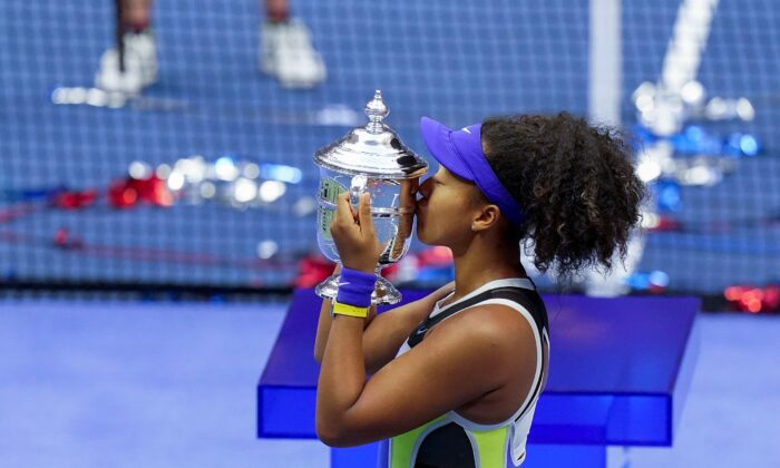 Naomi Osaka, of Japan, holds up the championship trophy after defeating Victoria Azarenka, of Belarus, in the women's singles final of the U.S. Open tennis championships in New York, on Sept. 12, 2020. (Seth Wenig/AP Photo)