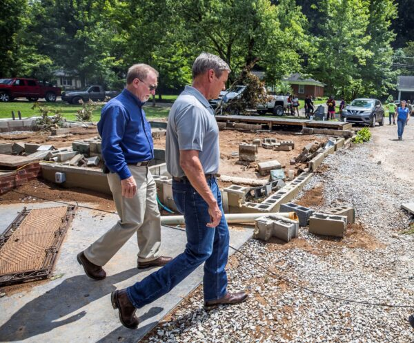 Tennessee Gov. Bill Lee (R) walks past a home
