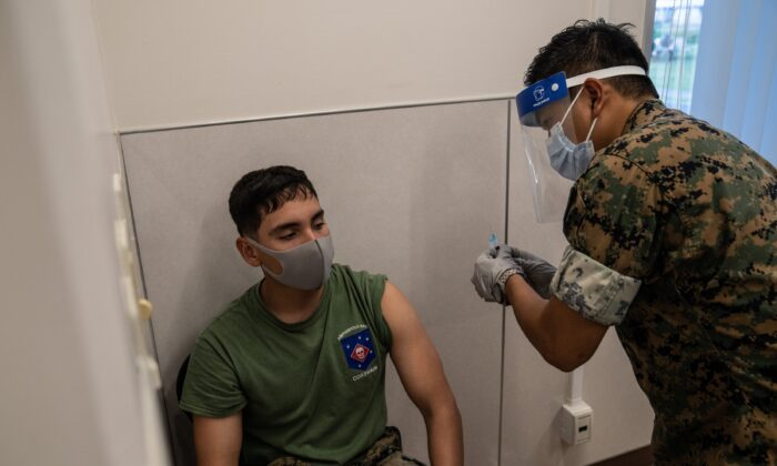 A U.S. Marine receives the Moderna COVID-19 vaccine at Camp Foster in Kin, Japan, on April 28, 2021. (Carl Court/Getty Images)