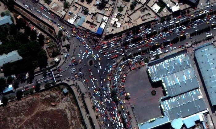 This satellite image shows crowds and traffic at the entrance to Kabul's international airport, Afghanistan, on Aug. 23, 2021. (Satellite Image ©2021 Maxar Technologies via AP)