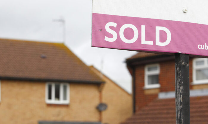 An estate agent's sold sign outside a property in a file photo dated Oct. 2, 2012. (Chris Ison/PA)
