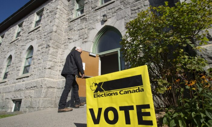 A voter enters a polling station as the advance vote in the federal election is opened on Oct. 11, 2019, in St-Georges Que. (The Canadian Press/Jacques Boissinot)
