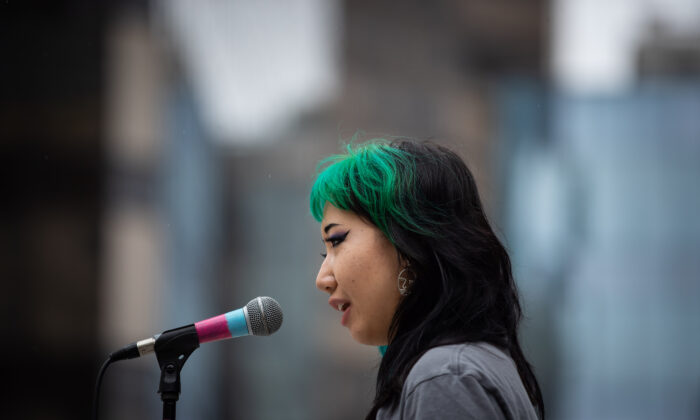 Nursing student Mona Wang attends a demonstration in Vancouver, on July 11, 2020. (The Canadian Press/Darryl Dyck)
