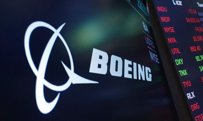 The logo for Boeing appears on a screen above a trading post on the floor of the New York Stock Exchange on Tuesday, July 13, 2021. (Richard Drew/AP Photo)