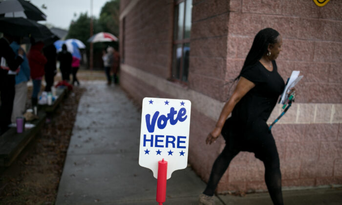 Residents of Charlotte, North Carolina, arrive at a polling station to vote on Nov. 6, 2018. (Logan Cyrus/AFP via Getty Images)