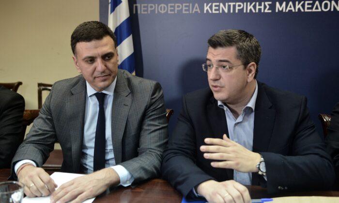 Governor of Central Macedonia region Apostolos Tzitzikostas (R) speaks next to Greek Health Minister Vassilis Kikilias (L) during a meeting in Thessaloniki, in the region of Central Macedonia,  on Feb. 26, 2020. (Sakis Mitrolidis via Getty Images)