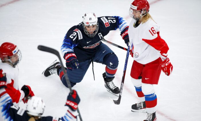 Hilary Knight of the United States (L) celebrates her goal as Russia's Ilona Markova looks on during second period IIHF Women's World Championship hockey action in Calgary, Alberta, Canada, on Aug. 24, 2021. (Jeff McIntosh/The Canadian Press via AP)