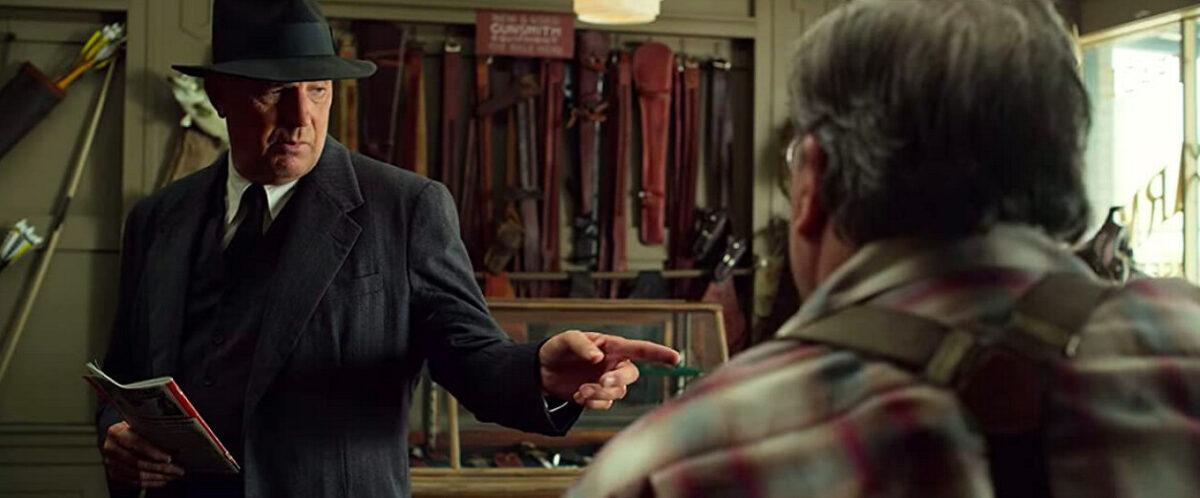 a man buys guns in a gunshop in THE HIGHWAYMEN
