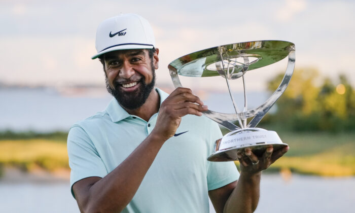 Tony Finau poses with the Wanamaker Trophy after winning The Northern Trust golf tournament at Liberty National Golf Course in Jersey City, N.J., on Aug. 23, 2021. (John Minchillo/AP Photo)