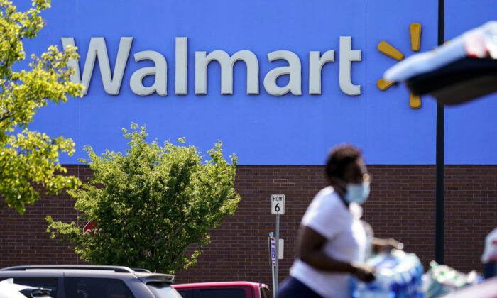 A shopper loads items into her car in the parking lot of a Walmart in Willow Grove, Pa., on May 19, 2021. (Matt Rourke/AP Photo)