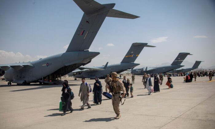 Members of the UK Armed Forces continue to take part in the evacuation of entitled personnel from Kabul airport, in Kabul, Afghanistan August 19-22, 2021, in this picture obtained by Reuters, on Aug. 23, 2021. (LPhot Ben Shread/UK MOD Crown copyright 2021/Handout via Reuters)