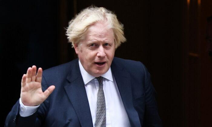 UK Prime Minister Boris Johnson waves as he walks on Downing Street in London, on Aug. 24, 2021. (Henry Nicholls/Reuters)