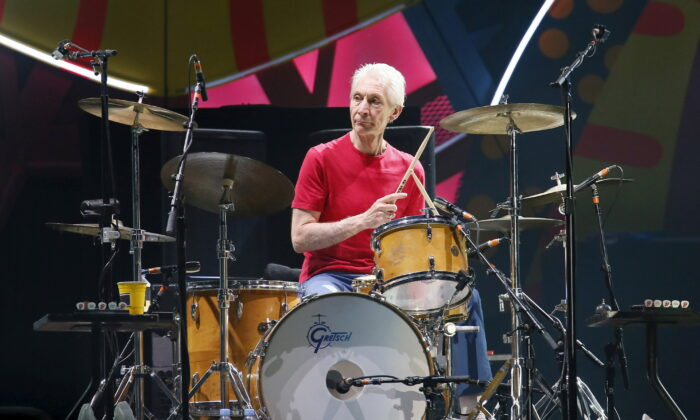 Charlie Watts of British veteran rockers The Rolling Stones performs with his band members Mick Jagger, Keith Richards, and Ronnie Wood during a concert on their Latin America Ole Tour in Santiago, Chile on Feb. 3, 2016. (Rodrigo Garrido/Reuters)